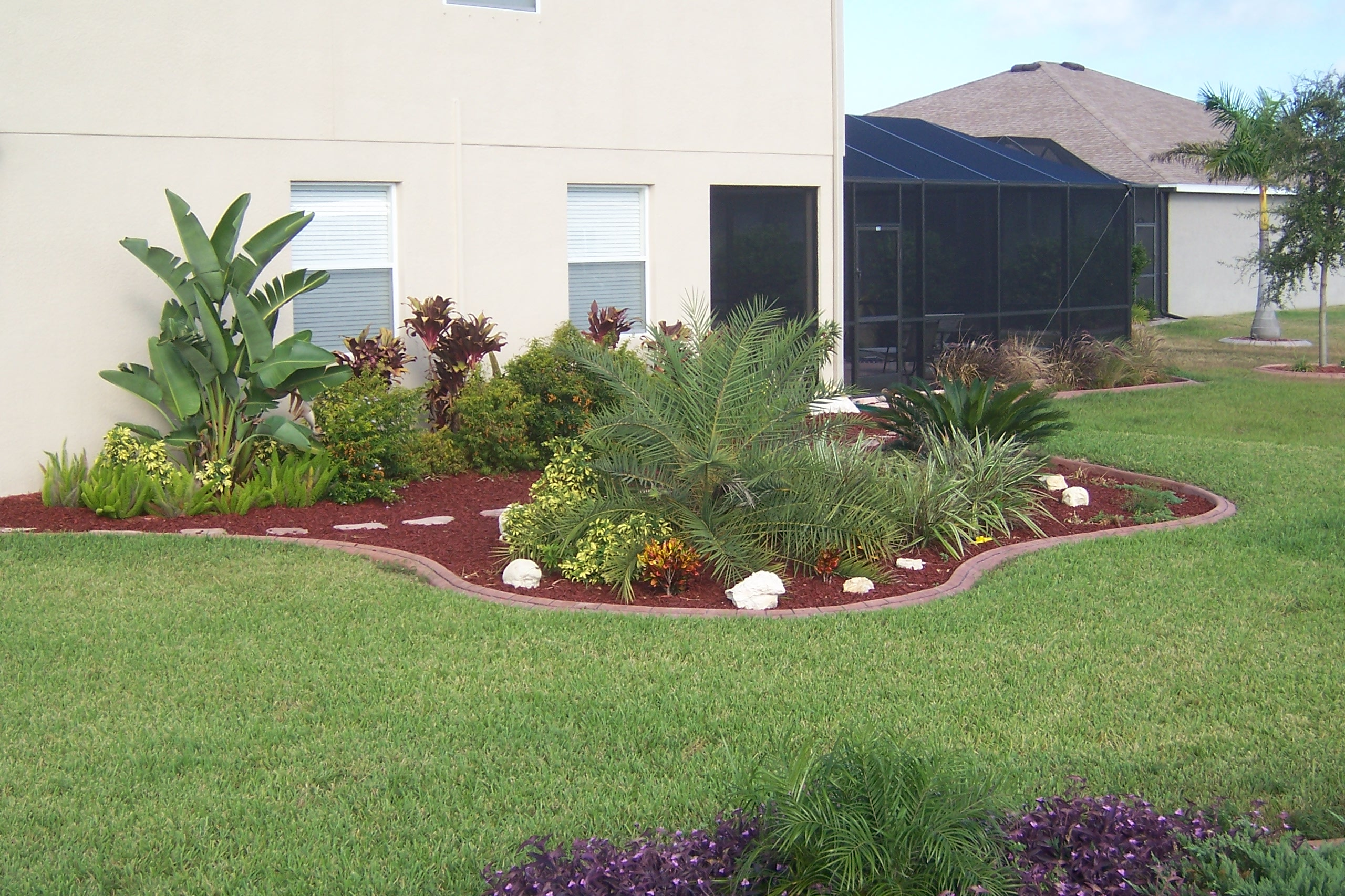 Beautiful new landscape and custom concrete curbing