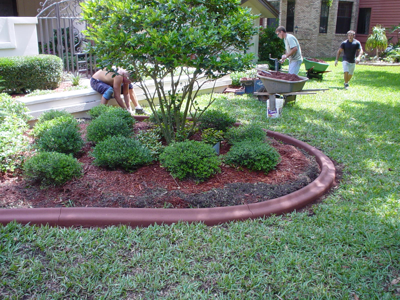 Professionals from Curb Appeal Curbing hard at work