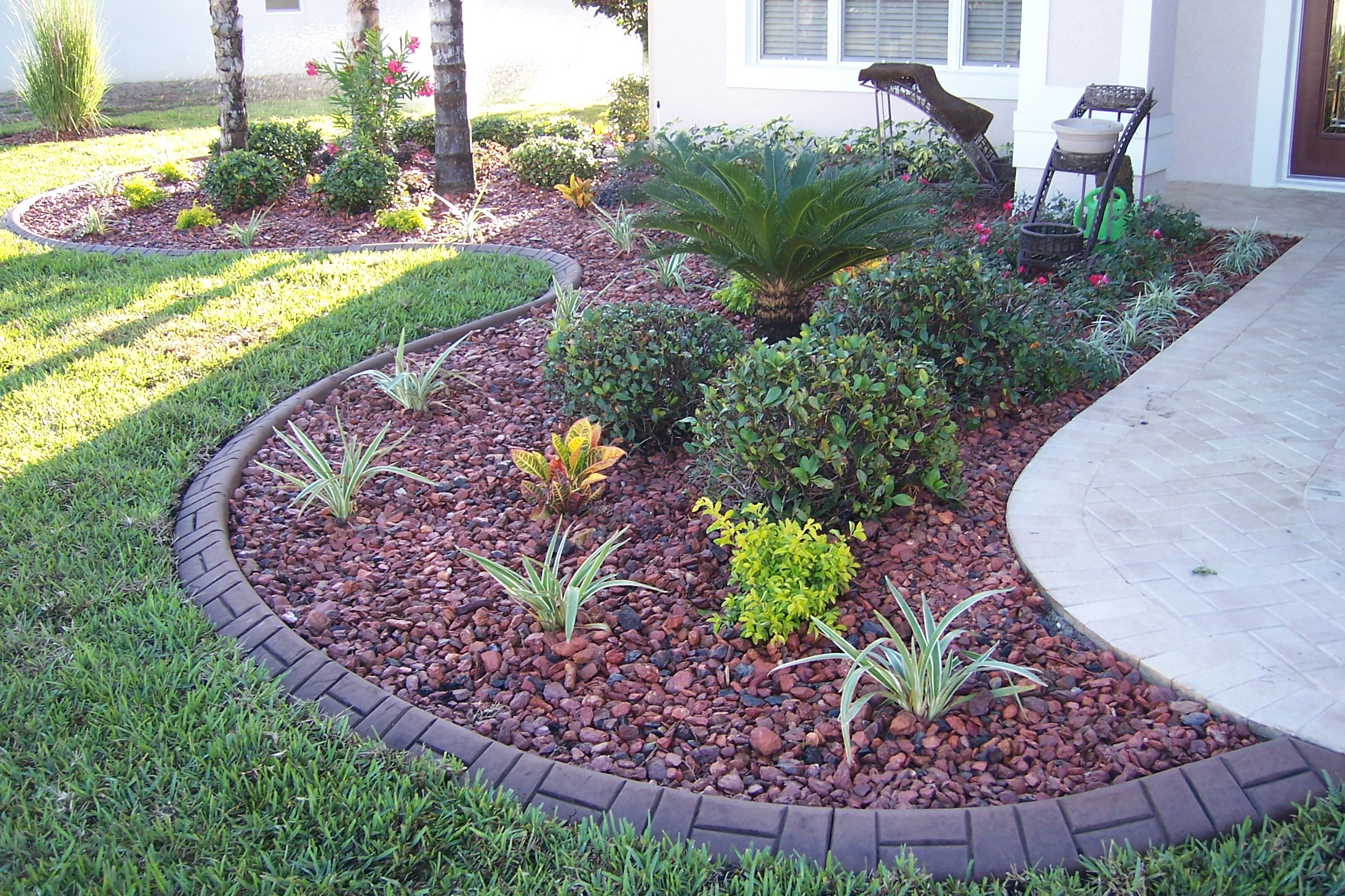 Great new front garden with a custom colored and patterned lawn curb