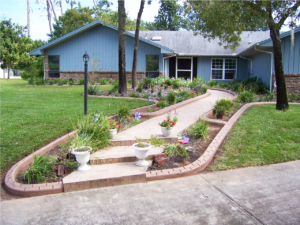 Custom Lawn curb and front steps of a new happy customer