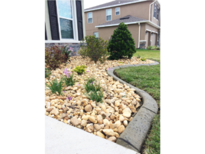 Brand new, custom landscape curb installed for rock garden