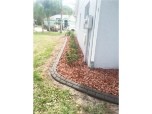 Lawn curb extending around customer's house