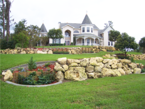 Enormous yard boasting plenty of custom curbs and gardens by Curb Appeal Curbing